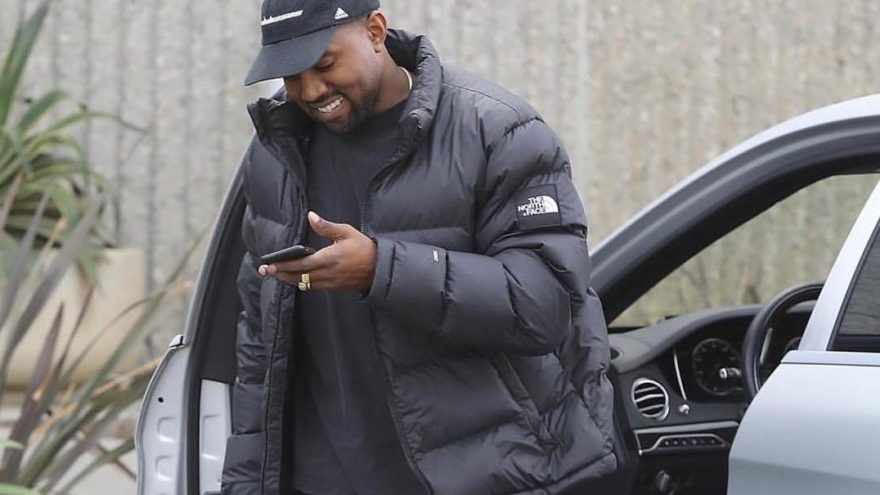 Kanye West looking at his phone