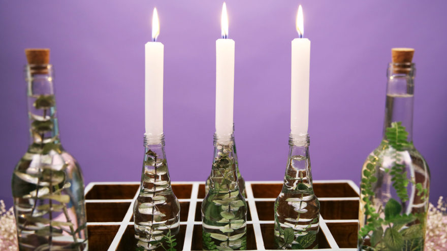 bottled upcycle DIY with lit candle